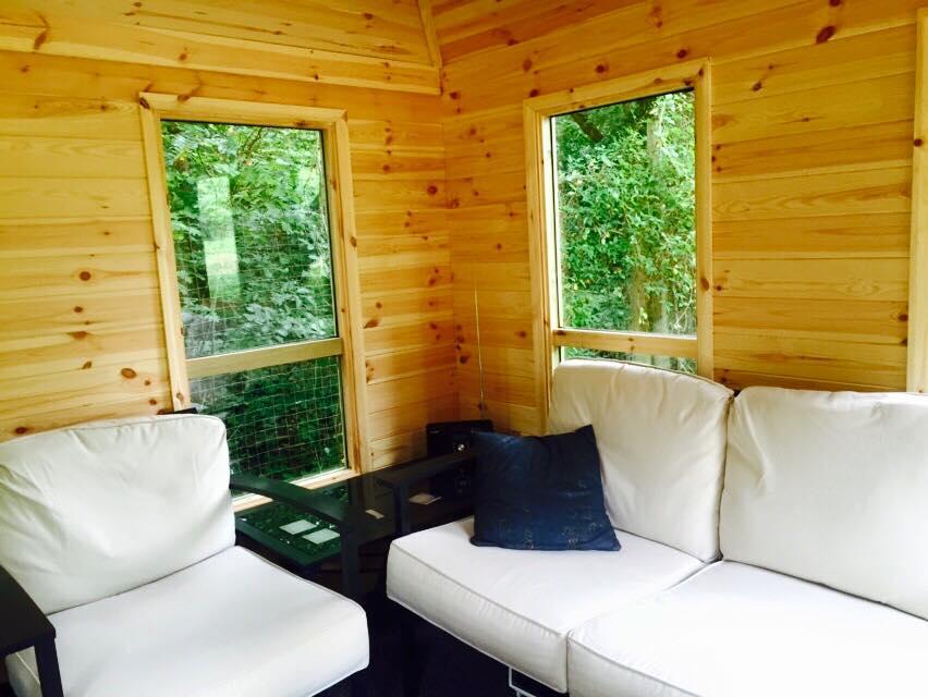 corner summer house with cedarwood shingles