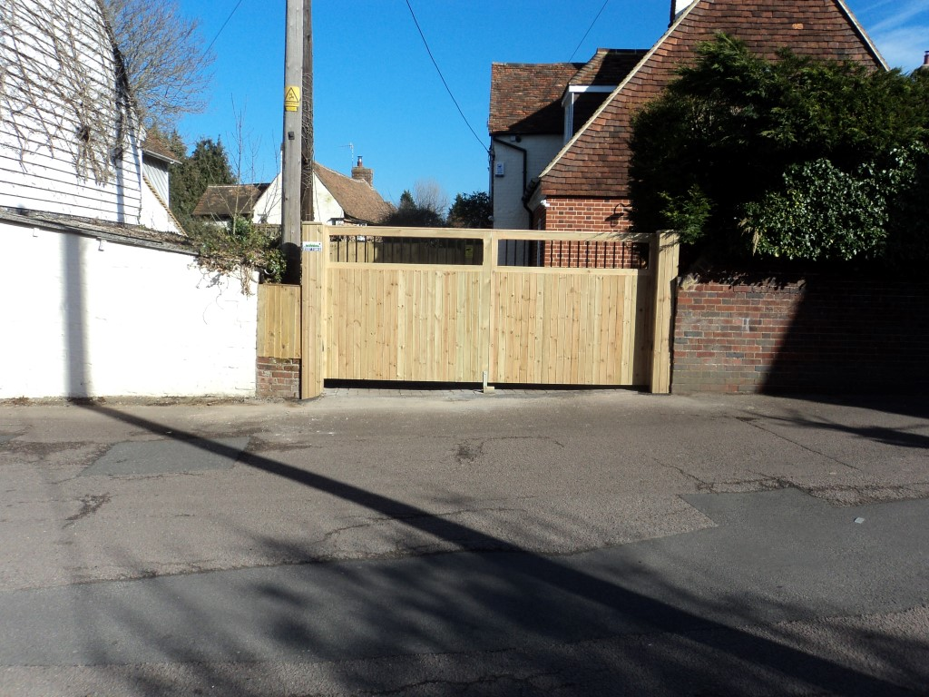 Metal inner framed gates timber clad boxed in posts!