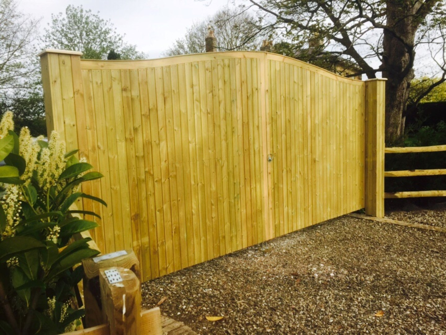 Metal inner framed gates with v-joint cladding to the posts. The gates are our omega top.